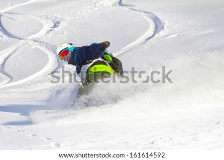 Male boarder rides back country