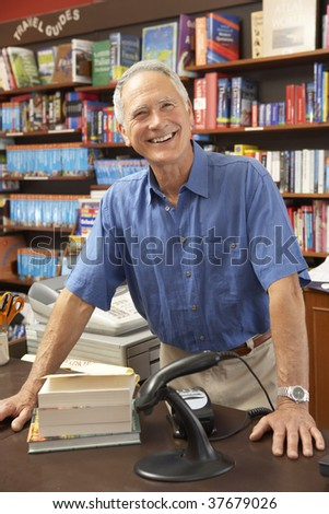 Male bookshop proprietor - stock photo