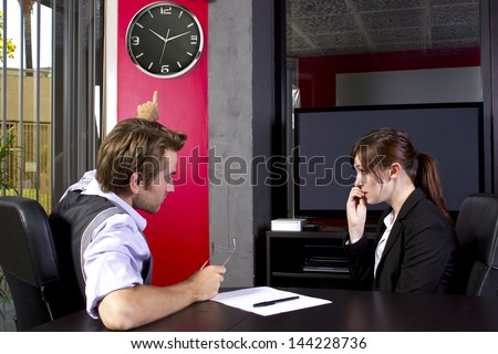 Male boss angry at late female employee - stock photo