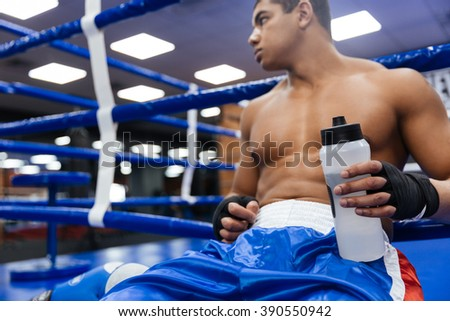 Male boxer drinking water - stock photo