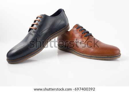 Male Brown and Blue Shoe on White Background, Isolated Product.