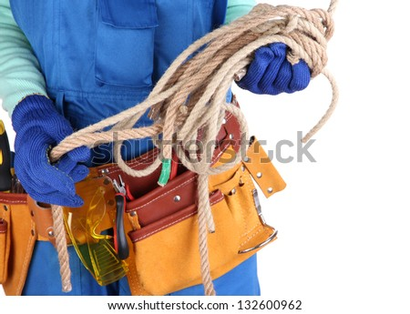 Male builder in blue overalls with rope isolated on white - stock photo