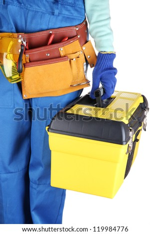 Male builder in blue overalls with yellow suitcase isolated on white - stock photo