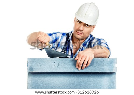 Male builder in working clothes, helmet and tools. Isolated over white. - stock photo