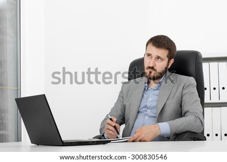 Male businessman sitting at the table