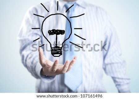 Male businessman with light bulb floating on hand. - stock photo