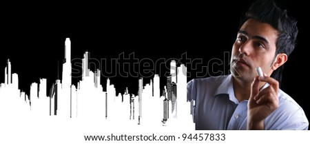 male businessman with marker in fictional house - stock photo