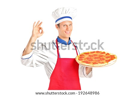 Male chef holding a pizza and gesturing with hand isolated on white background