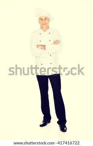 Male chef standing with folded arms - stock photo