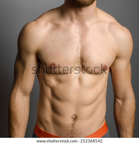 Male chest over grey background