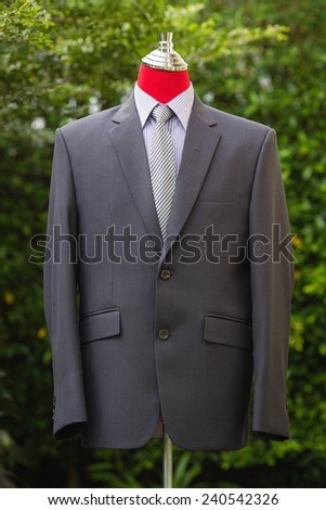 Male clothinh suit on stand - stock photo