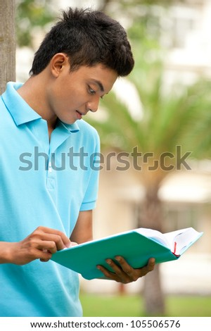Male college student studying exam - stock photo