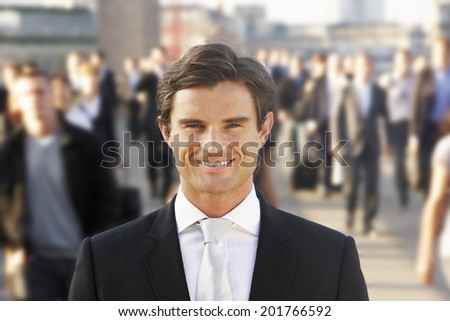 Male commuter in crowd - stock photo