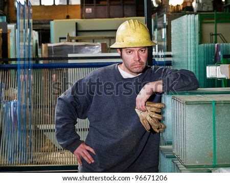 Male Construction Worker in shop - stock photo