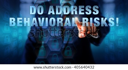 Male corporate manager is touching DO ADDRESS BEHAVIORAL RISKS! on an interactive visual screen. Business challenge metaphor and information technology concept for risks in computer usage patterns. - stock photo