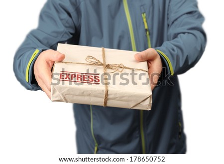 Male courier service worker or postman holding express delivery package - stock photo