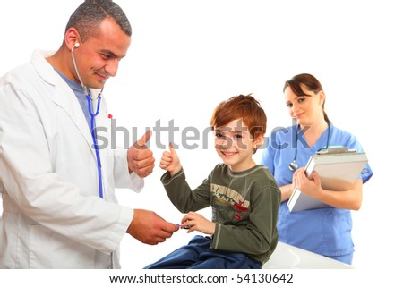 Male Doctor and  nurse examining a boy - stock photo