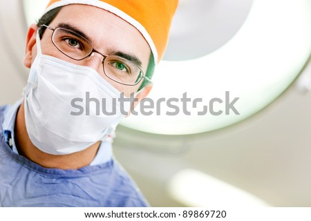 Male doctor at the operating room ready for surgery - stock photo