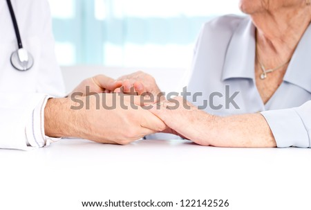 Male doctor discussing with his patient. - stock photo
