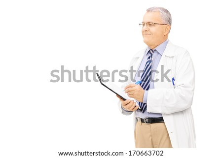 Male doctor in uniform holding a clipboard, isolated on white background - stock photo