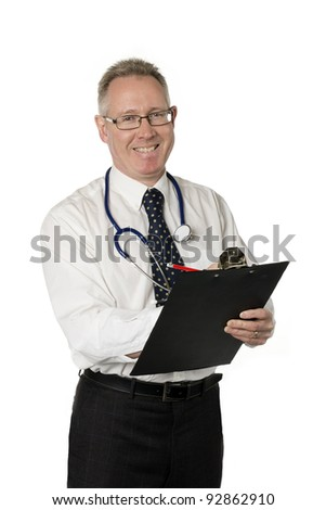 Male doctor isolated on white smiles and writes on clipboard - stock photo