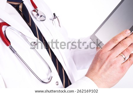 Male doctor use a digital tablet in his work. The Digital Hospital, with new and modern resources and easy access to the important information about the patients, test results and patient registration - stock photo