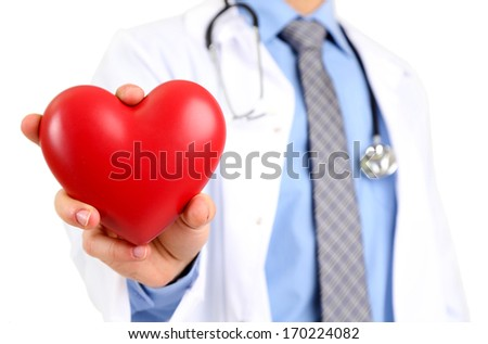 Male Doctor with red heart in his hands, isolated on white background - stock photo