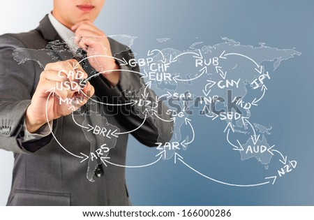 male drawing line and world currency code on world map - stock photo