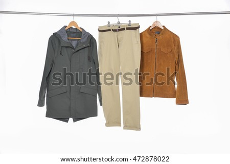 Male dress with coat isolated hanging on hangers