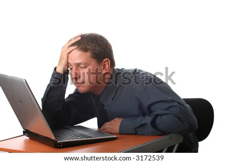 Male dressed in black sitting at office desk with laptop. Isolated - stock photo