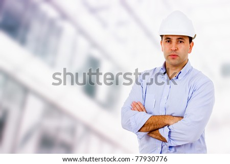 Male engineer standing at a building construction - stock photo