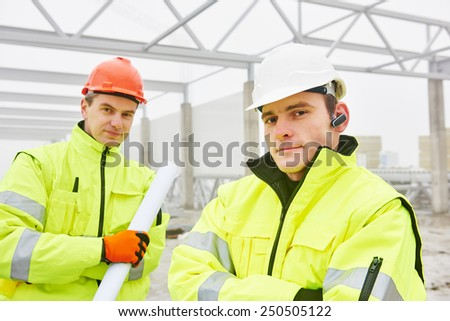 male engineers construction foreman managers outdoors indoors at building site with blueprints - stock photo