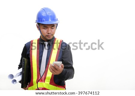 Male engineers using mobile phone at construction site