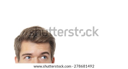 male eyes looking up towards copy space - stock photo