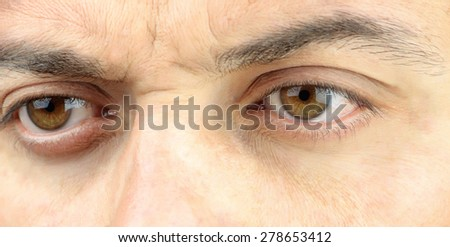 Male face closeup on eyes watching - stock photo