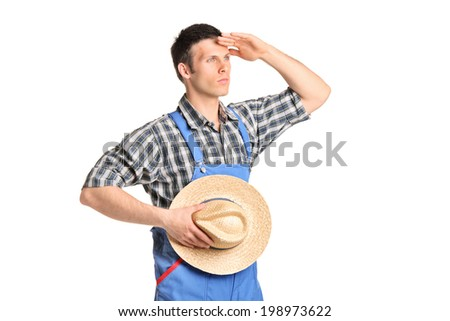 Male farmer in jumpsuit looking in the distance isolated on white background - stock photo
