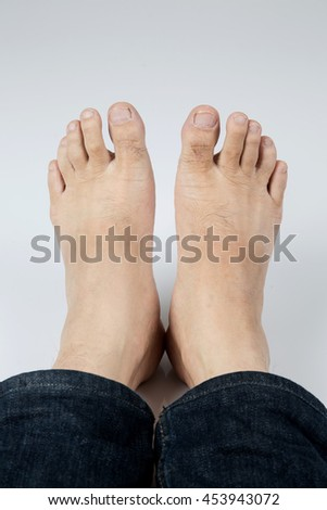 Male feet on gray background . With copy space