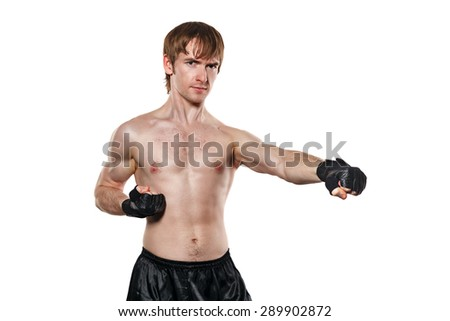 Male fighter in mixed martial fighting gloves kick. Isolated on white background. Healthy lifestyle concept.