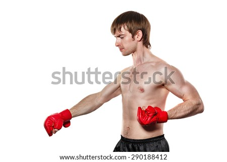 Male fighter kung fu strike directly down. Isolated on white background. The concept of martial arts. - stock photo