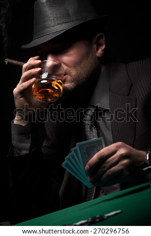 Male gambler playing poker, drinking whiskey and smokes a cigar, Dark color Intensity.