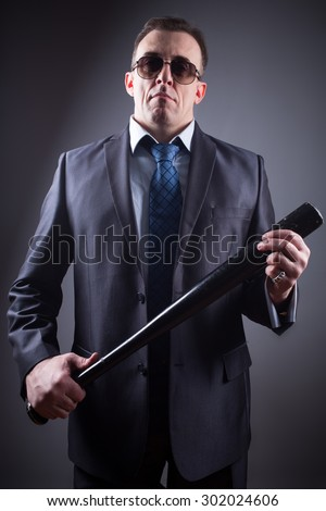 male gangster with baseball bat