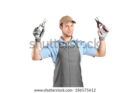 Male gardener holding pliers isolated on white background - stock photo
