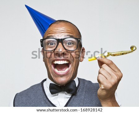 Male geek ready to celebrate for New Years, Christmas or any celebration - stock photo