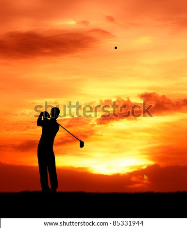 male golfer hit golf ball toward the hole at sunset silhouetted - stock photo