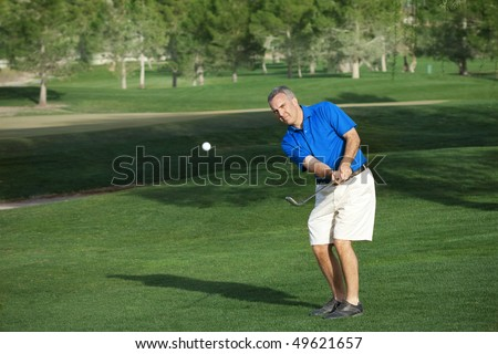 Male Golfer Playing Golf - stock photo