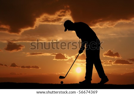 male golfer sunset - stock photo