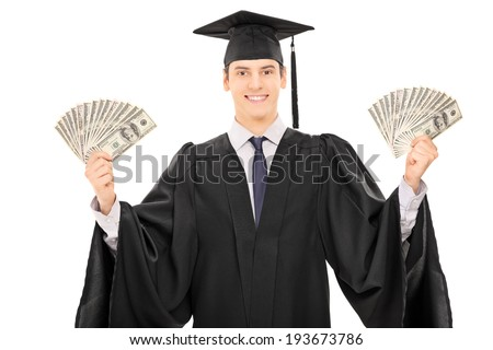 Male graduate student holding money isolated on white background - stock photo