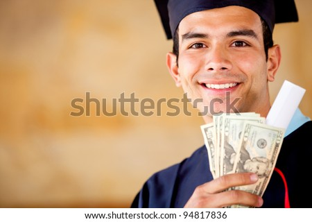 Male graduated holding money - Education costs concepts - stock photo
