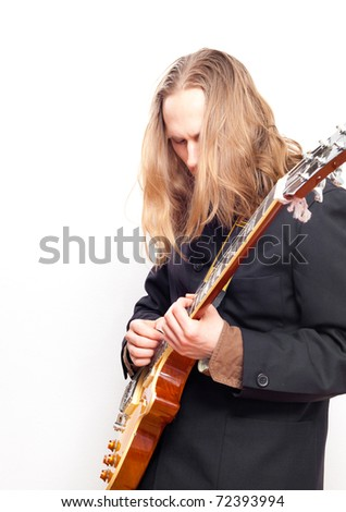 Male guitar player deepened into playing