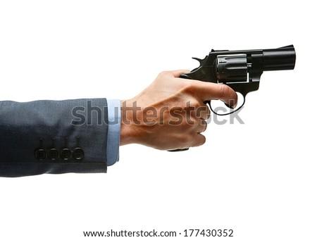 Male hand aiming revolver gun / studio photography of man's hand holding handgun - isolated on white background  - stock photo